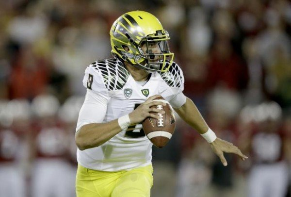hi-res-187298755-quarterback-marcus-mariota-of-the-oregon-ducks-looks-to_crop_north